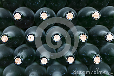Stacked and dusty wine bottles