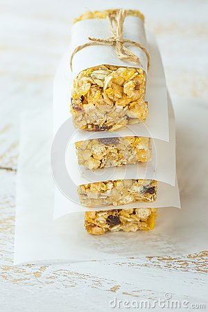 Free Stacked Homemade Granola Muesli Cereal Bars With Oats Nuts Raisins Honey Dried Apples. Lined With Parchment Paper Tied With Twine. Stock Image - 106002511