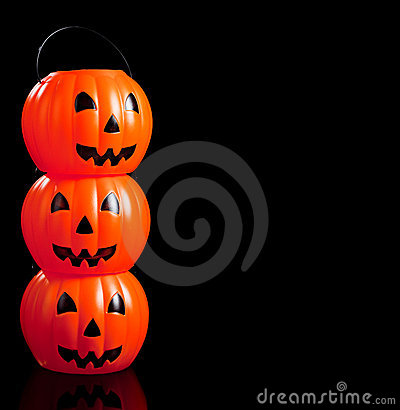 Stacked jack-o-lanterns on black
