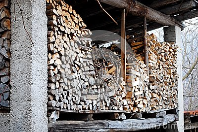 Stacked logs in the attic
