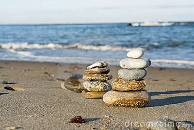 Stacked pebbles on beach