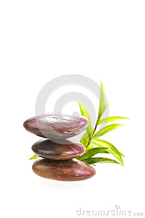 Stacked red river stones with bamboo