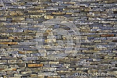 Stacked slate bricks wall texture