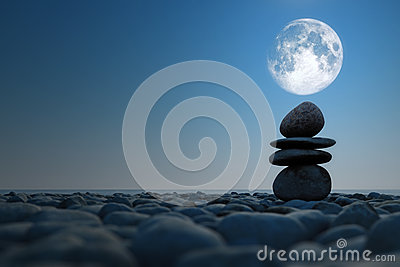 Stacked stones in moonlight