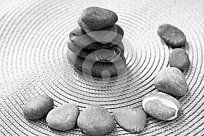 Stacked zen stones and stones in circle, bw