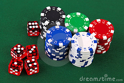 Stacks of casino chips and dice