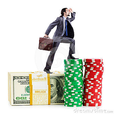 Stacks of chips and climbing businessman