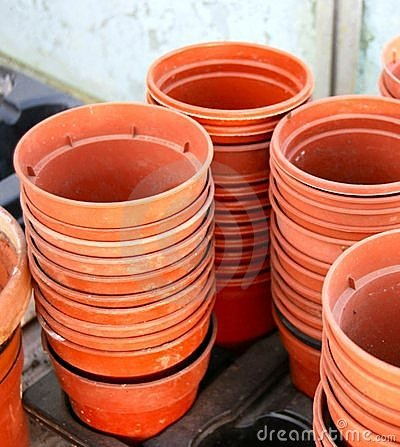 Stacks of empty plastic plant pots