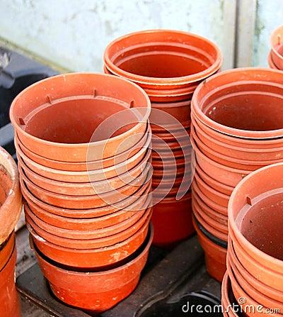 Stacks of empty plastic plant pots