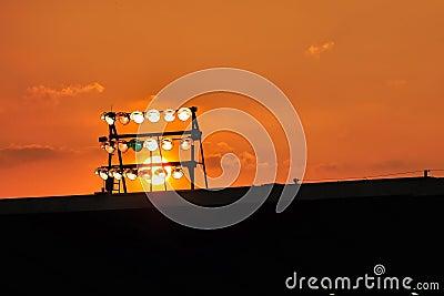 Stadium light against colored sky