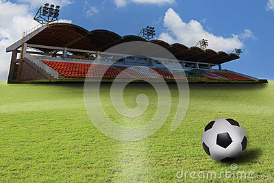 Stadium and  soccer football on green grass field