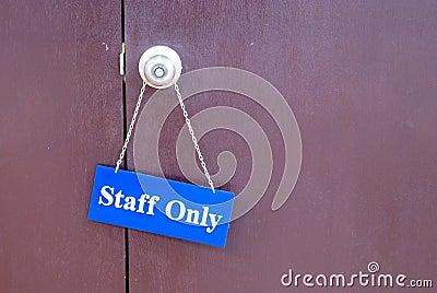 Staff Only hanging the door