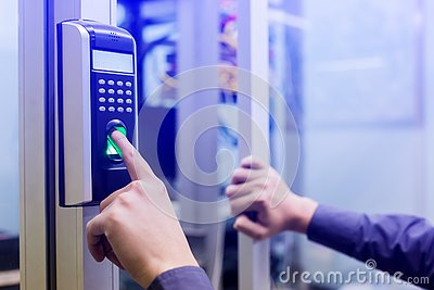 Staff push down electronic control machine with finger scan to access the door of control room or data center. The concept of data Stock Photo