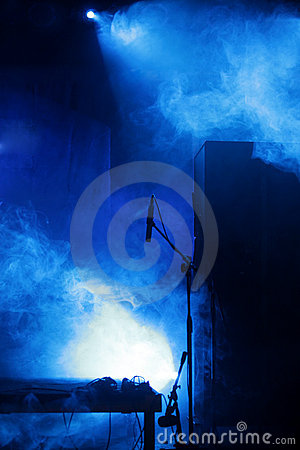 Stage with microphone and blue light
