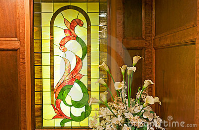 Stained glass window and plant
