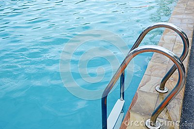 Stainless ladder in the pool