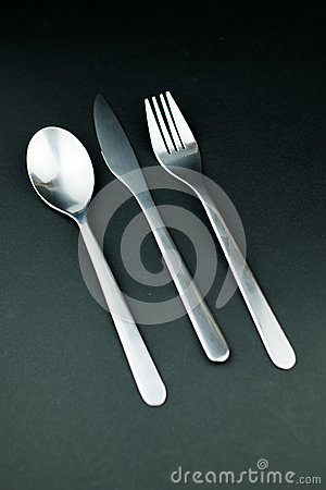 Free Stainless Steel Cutlery On A Dark Background Stock Images - 93554694
