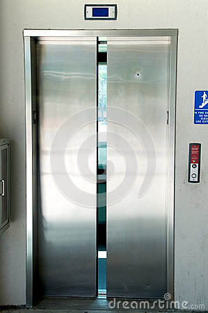 Stainless steel elevator doors closing