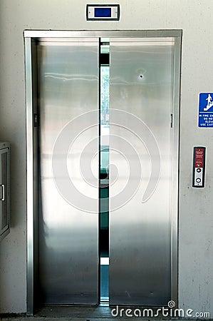 Stainless steel elevator doors closing
