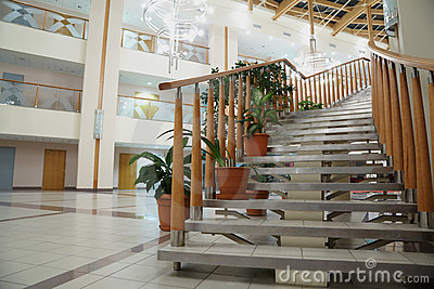 Staircase with banisters in large light hall