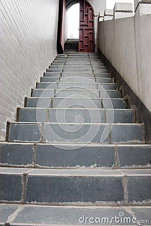 Stairs and ajar door