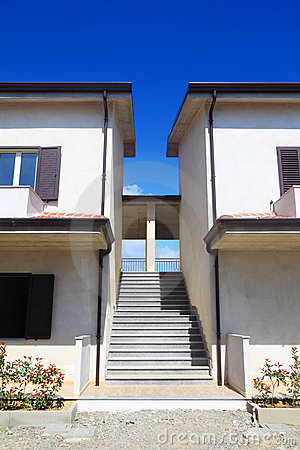 Stairs between two two-story houses