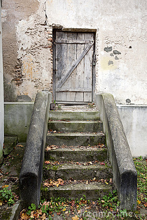 Stairs and wooden door in a wall