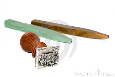 Stamp and sealing wax on white background