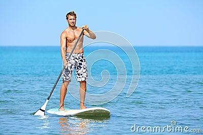 Stand up paddle board man paddleboarding