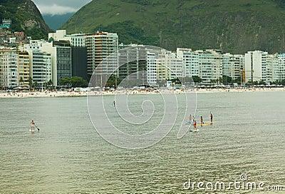 Stand Up Paddle in Copacabana Beach, Rio de Janeiro Editorial Photo