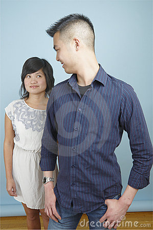 Standing Asian couple