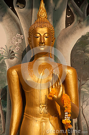 Free Standing Buddha Front Of Church On Thai Temple In Thailand. Royalty Free Stock Images - 53484849