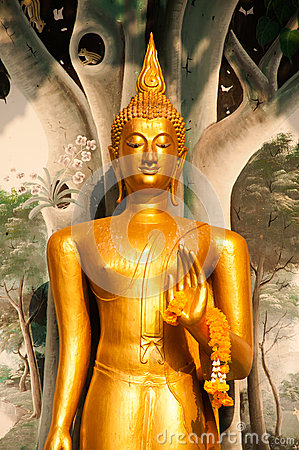 Free Standing Buddha Front Of Church On Thai Temple In Thailand. Royalty Free Stock Photography - 53484917