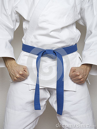 Free Standing Fighter Blue Belt Martial Arts White Suit Stock Photography - 54632272