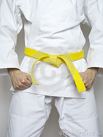 Free Standing Fighter Yellow Belt Martial Arts White Suit Stock Images - 54632034