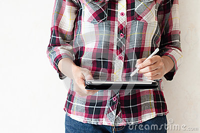 Standing girl writing on a tablet pc