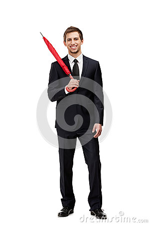Standing man with closed umbrella