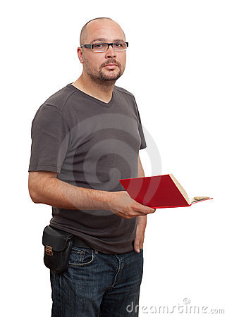 Standing man in glasses reads book