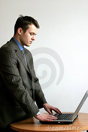 Standing man with his laptop