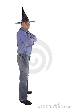 Standing man with put hands in witch hat