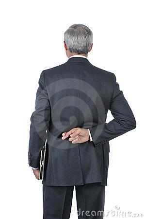 Standing Middle Age Businessman fingers crossed