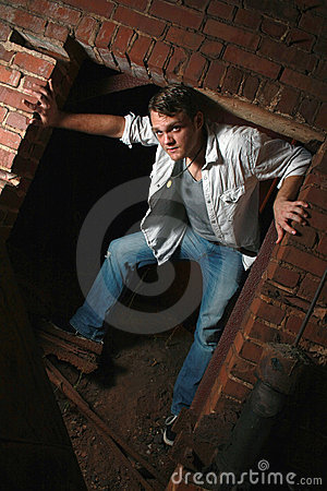 Standing in an old brick opening