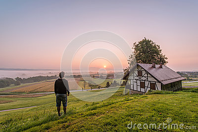 Standing Person On Grass Field Near House Free Public Domain Cc0 Image