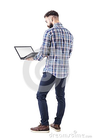Free Standing Professional Business Man Holding And Using Laptop Computer With Blank Screen Stock Photos - 115055553