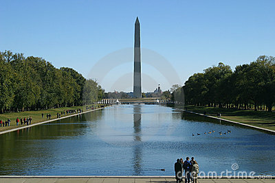 Standing at the reflecting pool