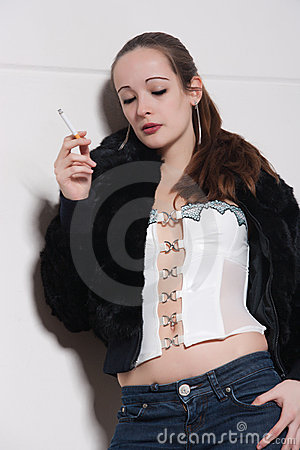 Standing relaxed against the wall smoking