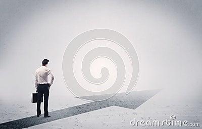 Standing salesman looking ahead with arrow