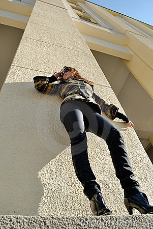 Standing woman in sun glasses, low angle view