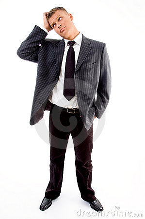 Standing young confused businessman