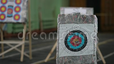 Stands with printed aim marks view. Someone shooting arrows at printed aim marks view stock footage